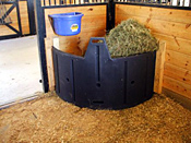 poly hay feeder in the corner of the horse stall