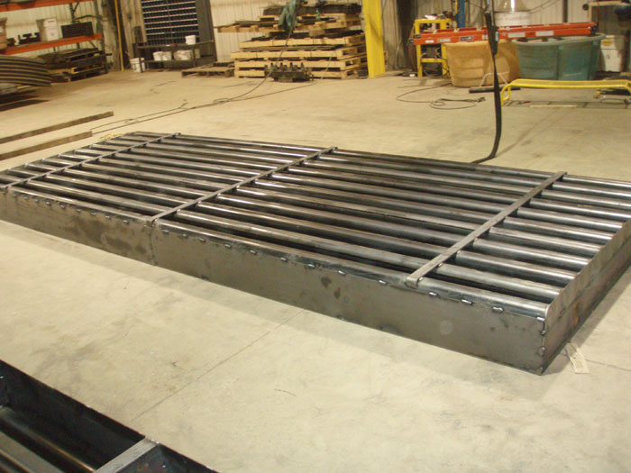 cattle guard with snowplow strips welded to the top rails