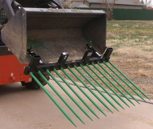 clamp on bucket fork with 13 spears on a tractor