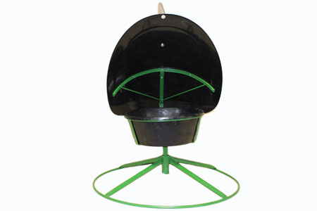 Mineral Feeder with a Wind Vane Hood on top for cattle and livestock