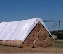 very large hay tarp covering round bales of hay
