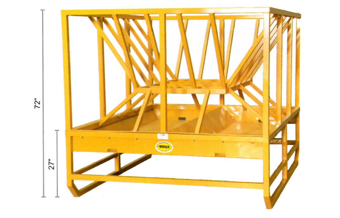 A large yellow cattle hay feeder that can also feed grain to livestock