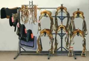 horse tack room organizer holding saddles, pad and blankets