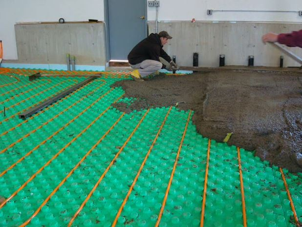 installing cement on top of floor insulation panels