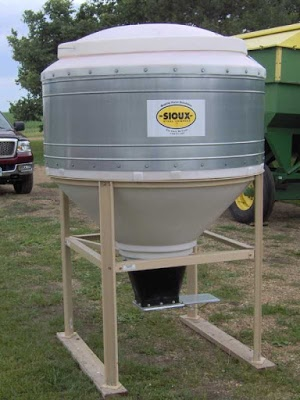 small feed bin assembled in a pasture