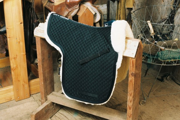 black sheepskin saddle pad with a pommel roll