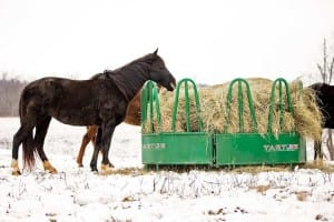 Flexible horse hay feeder collapses around large hay bales.