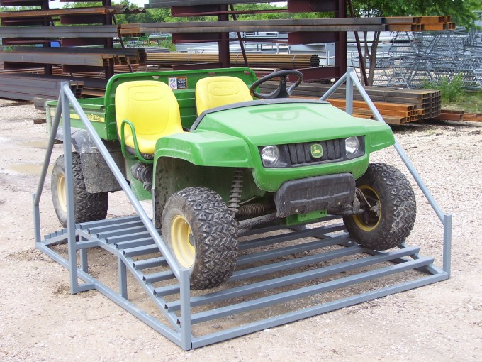 atv on a cattle guard crossing