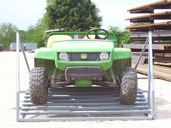 an atv on a cattle guard