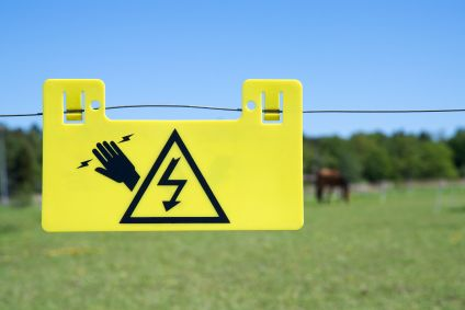 electric fence warning sign in yellow