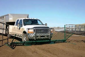 truck driving over a livestock gate