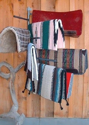 saddle pad rack holding saddle blankets