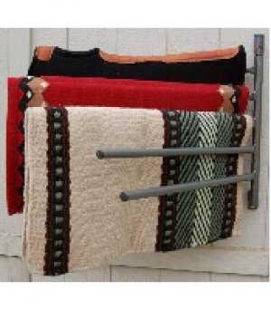 saddle pad rack holding saddle blankets on a wall
