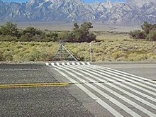 Virtual Cattle Guard painted on the road